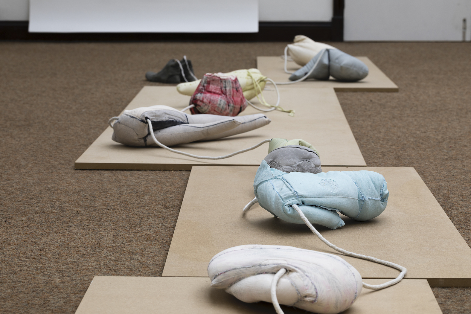 13 Untitled (eleven), jesmonite, rope, concrete, on mdf, 675 x 60 x 18 cm, Worthing Museum, photo Andrew Youngson